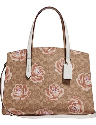 Coated Canvas Signature Rose Print Charlie Carryall On Coach